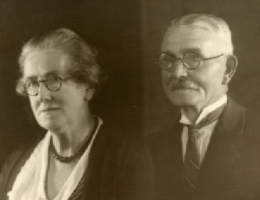 Sepia photograph of Alice and Thomas in formal 1930s attire.