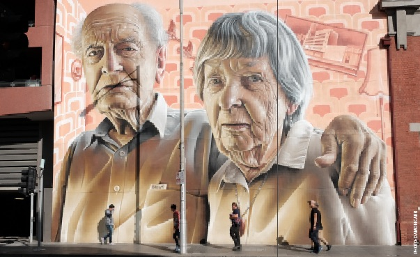 Street mural of an elderly man and woman. The mural is very large - the figures are about 5 metres tall.