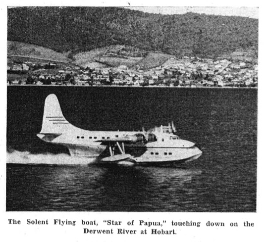Image of a seaplane on the water. Caption: The Solent Flying boat, 'Star of Papua', touching down on the Derwent River at Hobart.