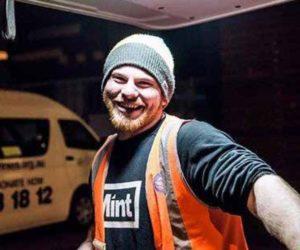 Man smiling wearing high viz vest.