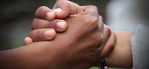 Two hands clasped.