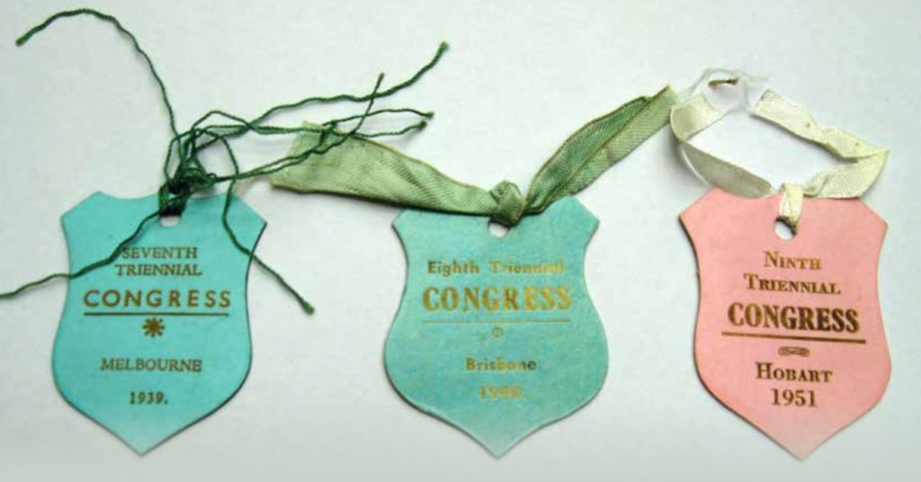 Three badges from the 7th, 8th and 9th congresses.