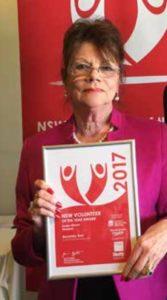 Bev Kerr holding her NSW Volunteer 2017 award.