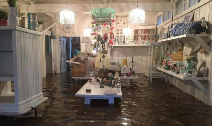 Homewares shop with several centimetres of water on the floor.