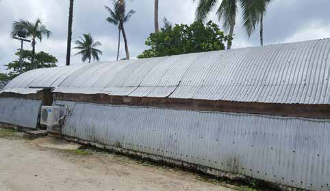 A long building that seems to be made of corrugated iron.