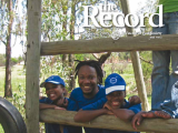 Thumbnail: The Record, photo of a man and two children.