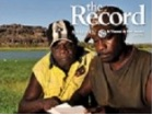 Thumbnail: The Record, two Indigenous men with Uluru in the background.