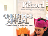 Thumbnail: The Record, Christmas Appeal, image of woman and child with Christmas cracker hats.