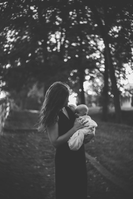 Woman holding a baby.